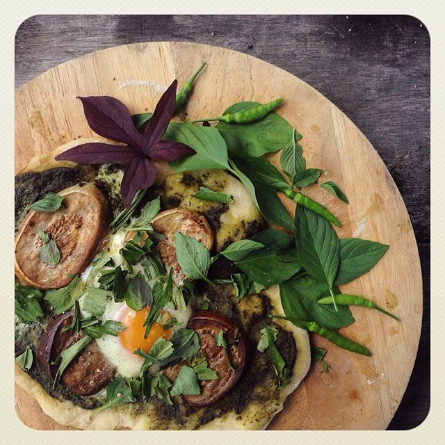 Cob-oven baked pizza topped with homemade pesto, fresh vegetables and herbs & eggs from our happy hens - courtesy of our Gasing garden. Need I say more?